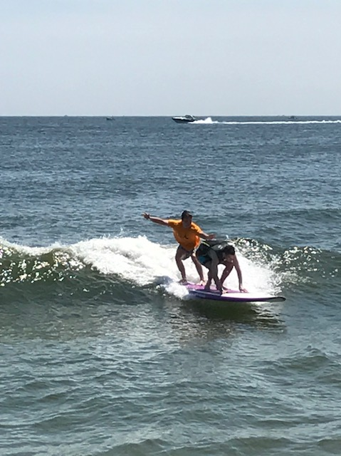Brian Mackey on surfboard in Long Branch during Surfing for Vision 2017