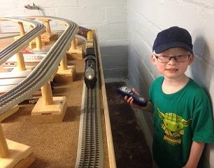 Luke playing with train