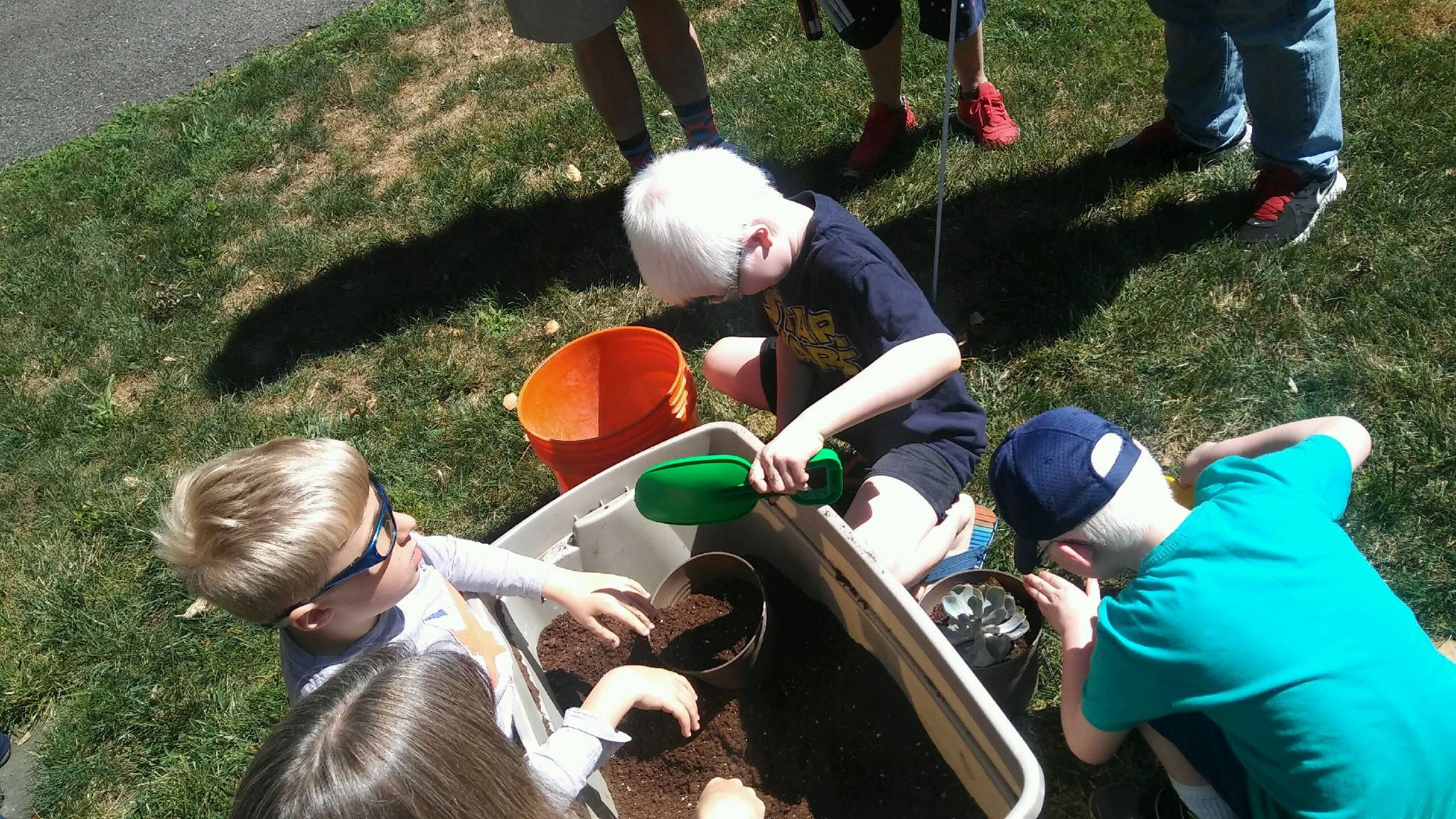 BELL Children preparing flower pots for completed planters