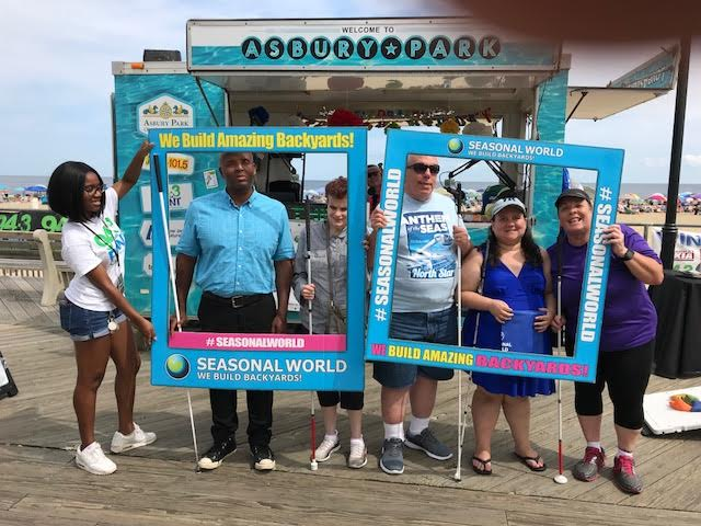 Lerone Walker, Mary Jo Partyka, Joseph Ruffalo, Vee Gaspa and Linda Melendez at the Asbury Park Beach for the Asbury Park Beach Day on August 25, 2018