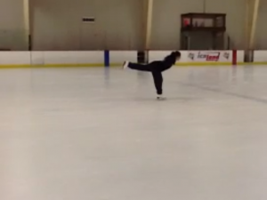 Marian Lee, member of the NFBNJ Capital Chapter, doing a spiral during a practice skate
